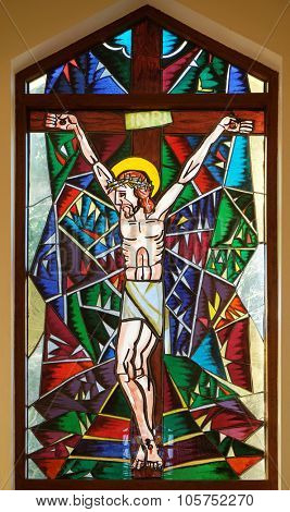 MACELJ, CROATIA - MARCH 21: Crucifixion, stained glass window in Memorial Church of the Passion of Jesus in Macelj, Croatia on March 21, 2015
