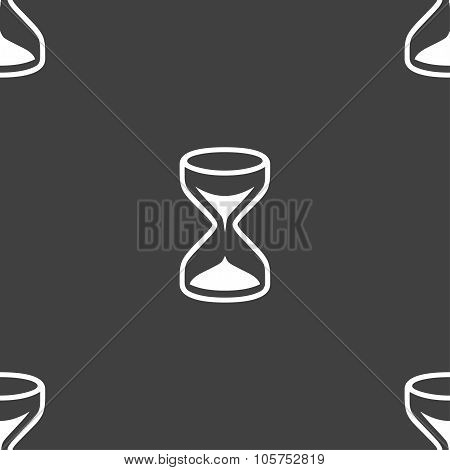 Hourglass Sign Icon. Sand Timer Symbol. Seamless Pattern On A Gray Background. Vector
