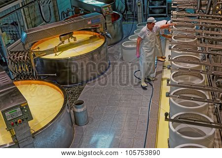 Production Of Gruyere Cheese At The Modern Industrial Cheese-making Factory Of Gruyeres