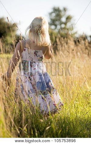 Girl Walking Though Long Grass