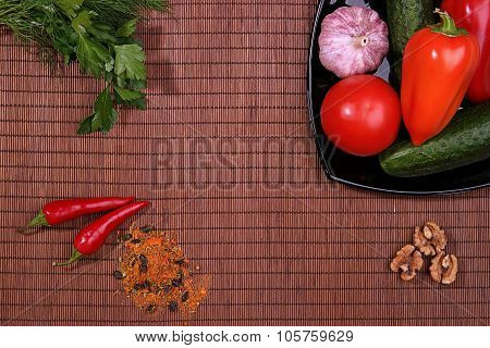 Vegetables and Spices in dish on table, top view