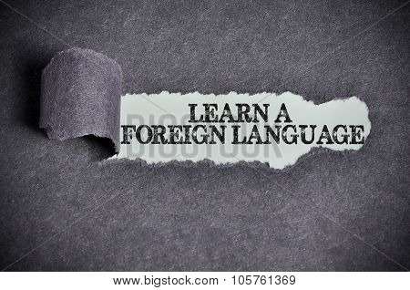 Learn A Foreign Language Word Under Torn Black Sugar Paper