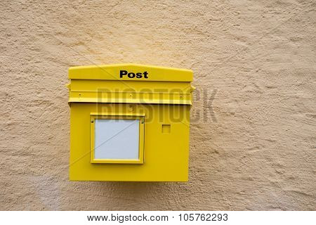 Yellow Postbox On The Wall