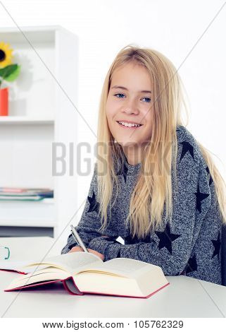 Blond Girl Doing Homework