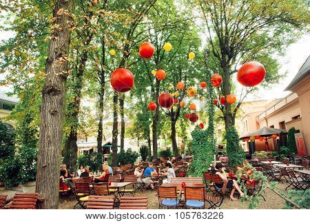 Lounge Restaurant With People Relaxing Under Green Trees