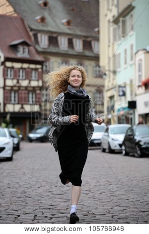 Blond Lady Running Along Street