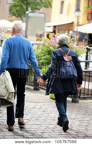 Senior Couple Walking Down Street