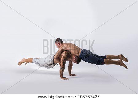 Male Acrobatic Dancers Balancing in Studio