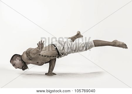 Male Acrobatic Dancer Balancing in Studio