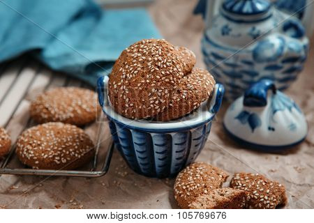 Fresh Baked Oatmeal Cookies With Sesame Seeds In A Cup. Sesame Chip Cookies On The Grid For Baking A