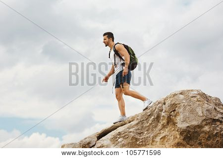 Young man tourist with a backpack