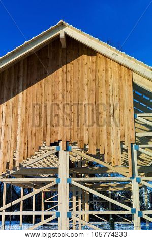 wooden roof construction, symbol photo for home, house building, and house financing