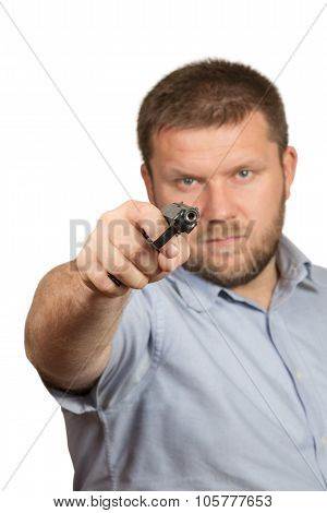 Bearded man threatening gun