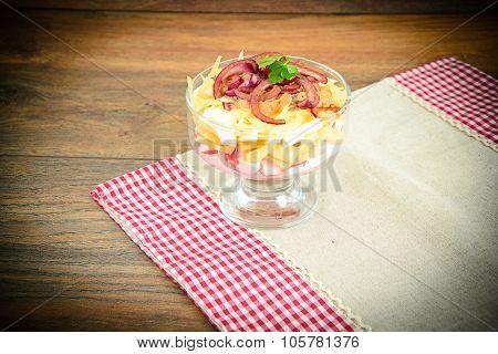 Salad of crab sticks, apple, eggs, cheese