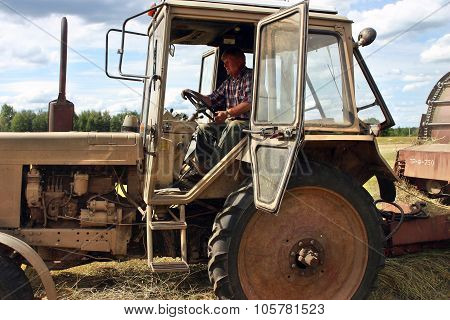 Cabins Tractors With Opened Door farmer Tractor-driver Working On Hayfield.