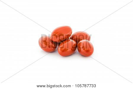 red vitamin capsules isolated on white background