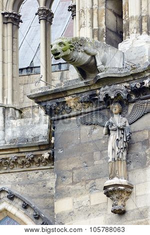 Stone sculptures on the facade of the cathedral Notre-Dame de Reims