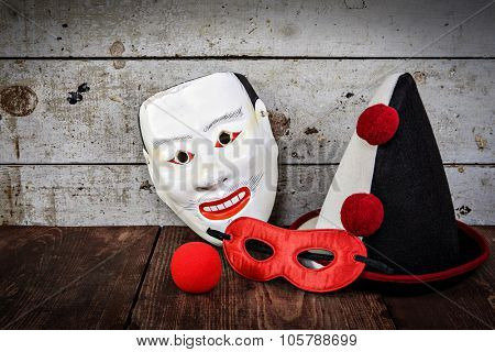Vintage carnival masks, hat and nose, shallow focus, focus on clown hat.