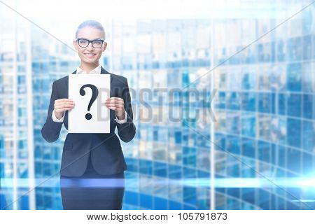 Half-length portrait of business woman handing question mark, blue background. Concept of problem and solution