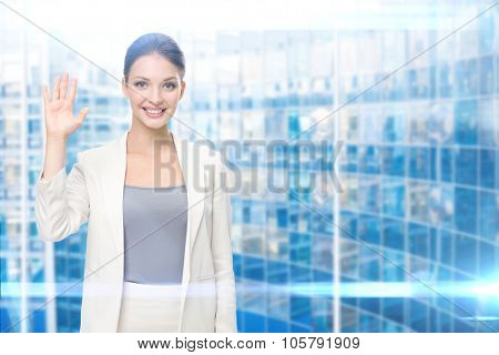 Portrait of businesswoman showing palm, blue background. Concept of leadership and success
