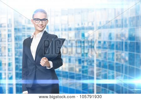 Portrait of wearing glasses business woman who hands black folder, blue background. Concept of leadership and success