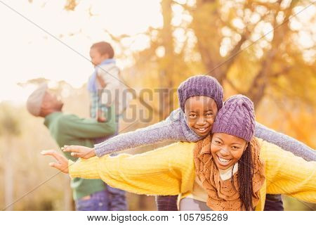 View of a happy young family on an autumns day