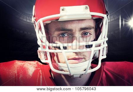 Portrait of american football player wearing his helmet against american football arena