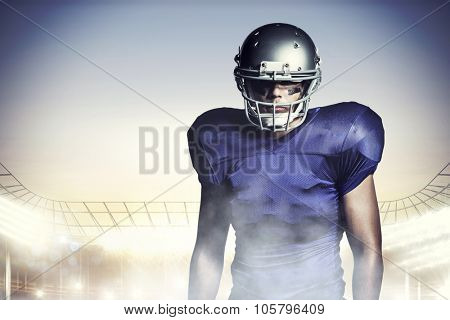 American football player standing against rugby stadium