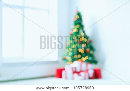 holidays, celebration and home concept - living room with christmas tree and presents background