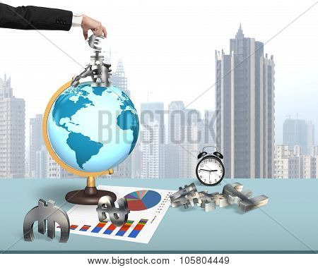 Human Hand Taking Money Symbols On Terrestrial Globe