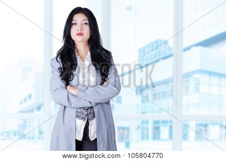 Confident Businesswoman Folded Hands