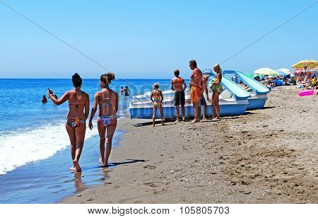 People relaxing on Fuengirola beach.