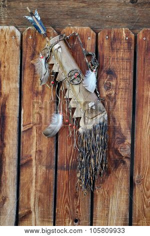 tribal native american bow with feathers background