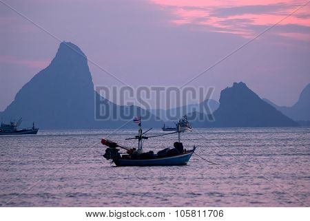 Fishermen Boat At Sunset In Thailand.