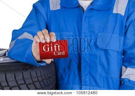 Male Mechanic Showing Gift Card