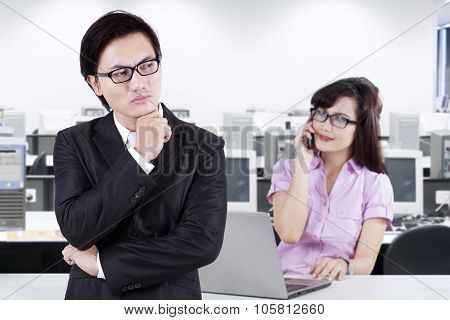 Male Manager Looking At His Subordinate