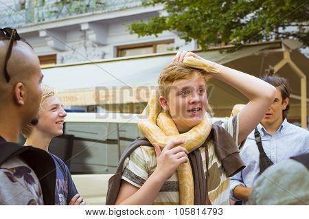 Red-haired Boy With A Huge Yellow Boa Snake