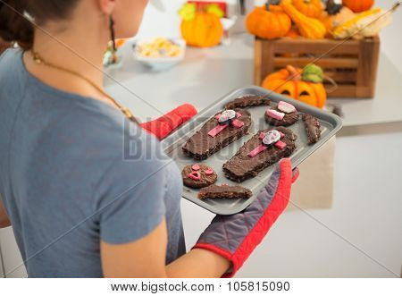 Closeup On Tray With Halloween Biscuits In Hands Of Housewife
