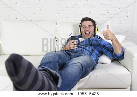 20S Or 30S Man Having Fun Listening To Music With Mobile Phone And Headphones