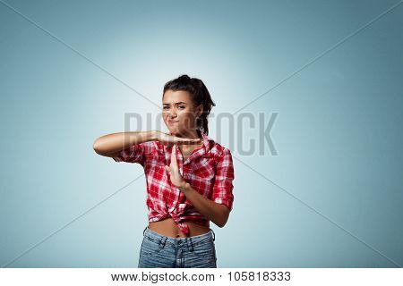 Closeup Portrait Of Attractive Young Serious Woman Showing Time Out Gesture With Hands, Isolated On