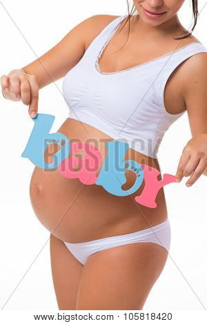 Pregnancy. Motherhood. Blue And Pink Text «baby» On Pregnant Belly. Twins, Girl Or Boy.
