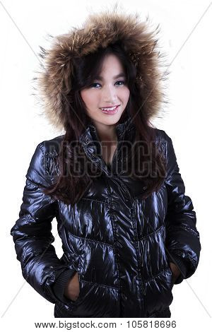 Young Woman In Winter Clothes With Fur Hood