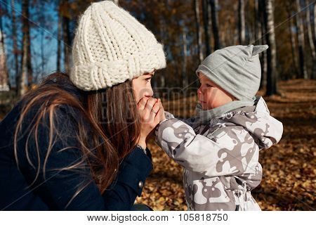Attractive Young Mom And Son Looking On Each Other. Portrait Of A Happy Mother And Baby. Mother With