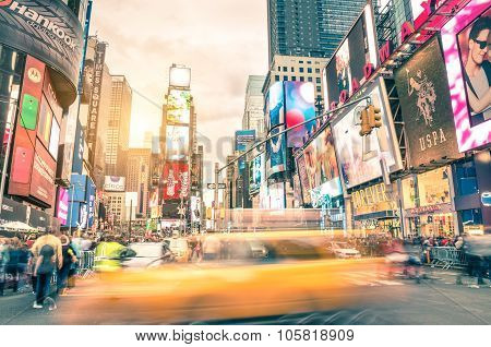 Blurred Yellow Taxi Cab And Rush Hour Congestion At Times Square In Manhattan - New York