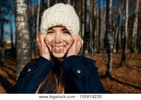 Close Up Portrait Of A Beautiful Very Cute Autumn Girl Playing In City Park. Fall Woman Portrait Of