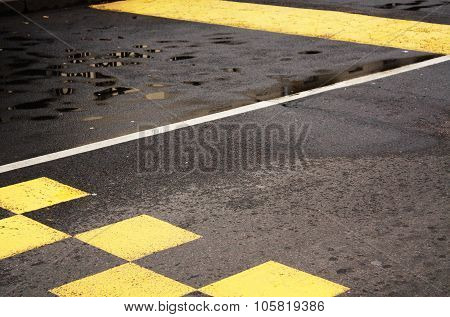 White And Yellow Road Marks On Asphalt.