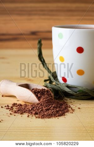 Cocoa In Wooden Spoon And Spotted Cup