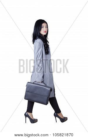 Businesswoman With Suitcase Walking In The Studio