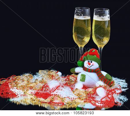Glasses of champagne with snowmen decorated