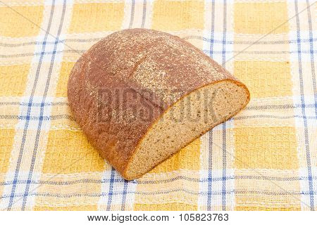 Brown Bread On A Checkered Tablecloth.